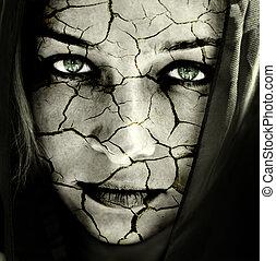 Cara de mujer con la piel rota