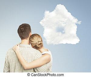 Casa de parejas y nubes