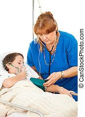 Enfermera cuidando a un niño enfermo