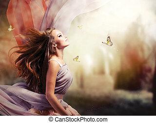 Hermosa chica en un jardín de primavera místico y mágico