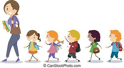 Los niños siguen a su maestra