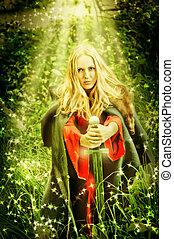Mujer bruja en el bosque encantado