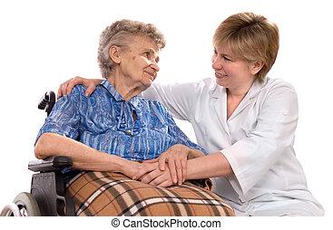 Mujer mayor en silla de ruedas