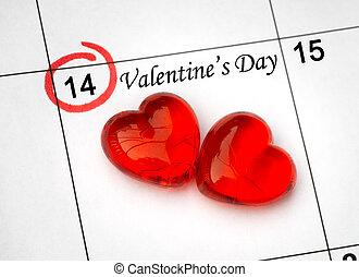 Página de calendario con los corazones rojos el 14 de febrero de San Valentín.