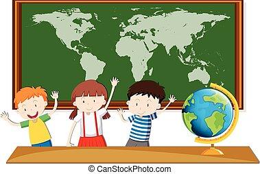 Tres estudiantes estudian geografía en clase