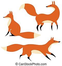 Tres zorros rojos en movimiento