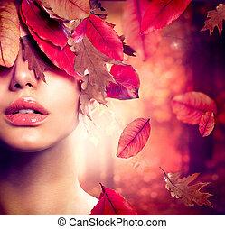 Un retrato de mujer de otoño. Cae