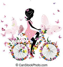 Una chica en bicicleta con mariposas románticas