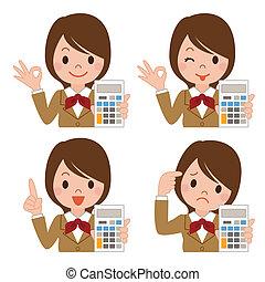 Una colegiala con una calculadora
